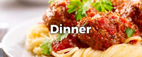 Spaghetti and meatballs with Dinner written on top of it